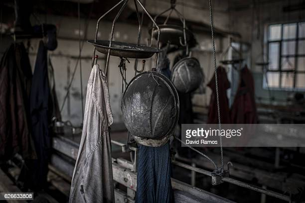 Boots helmets and clothes of the last coal miners of mine Pozo Calderon closed last August hang at the changing room on November 25 2016 in...