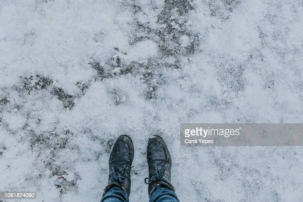 boots in snow - snow boot stock photos and pictures