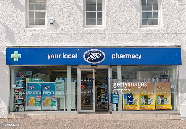 boots local pharmacy facade - ankle boot stock photos and pictures