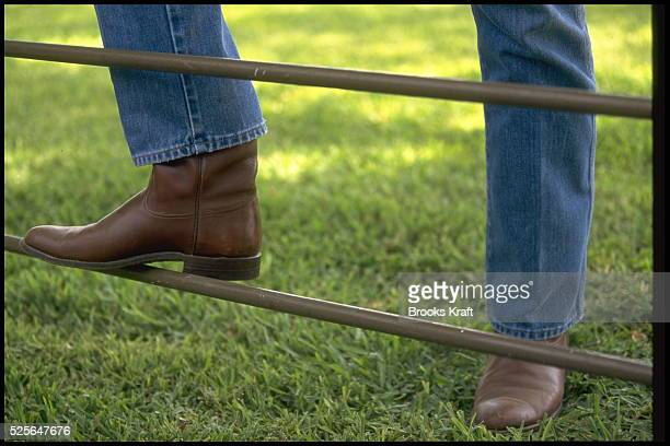 Boots of George W Bush Republican candidate for US President as he speaks to the media at his ranch in Crawford Texas