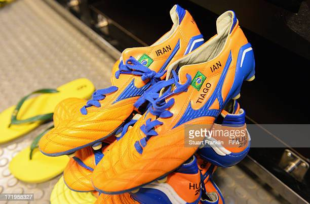 Boots on display in the Brazil changing room prior to the FIFA Confederations Cup Brazil 2013 Final match between Brazil and Spain at Maracana on...