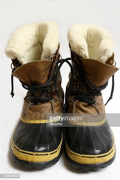 boots on white - snow boot stock photos and pictures