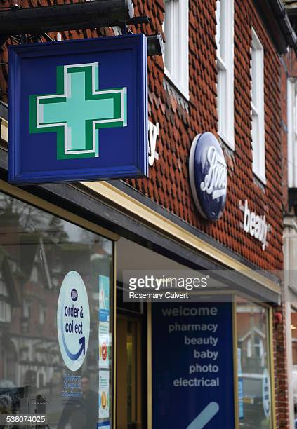 Boots pharmacy green cross logo and shop Haslemere Surrey England Boots is UK's leading pharmacyled health and beauty retailer with 2500 stores...