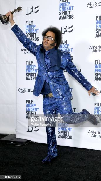 Boots Riley poses in the press room with the Best First Feature award for the film Sorry to Bother You during the 2019 Film Independent Spirit Awards...