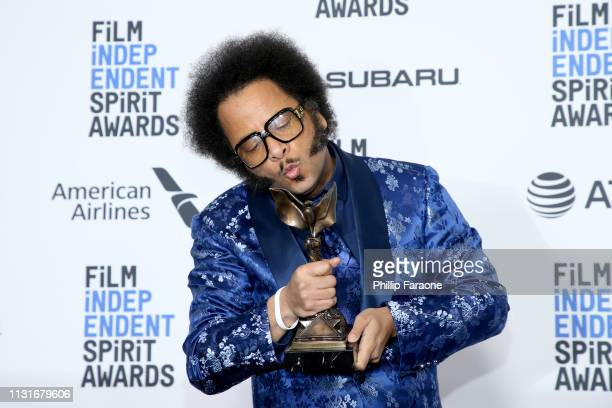 """Boots Riley poses in the press room with the Best First Feature award for the film """"Sorry to Bother You"""" during the 2019 Film Independent Spirit..."""