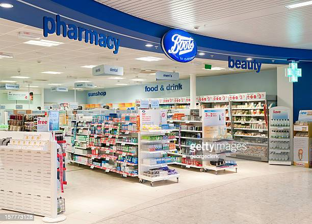 boots shop entrance - boot stock pictures, royalty-free photos & images