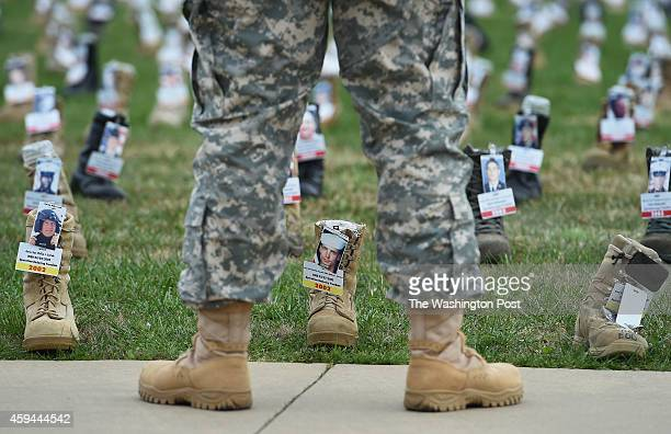 Boots symbolizing each soldier that has died during the United States' recent wars in Iraq and Afghanistan are displayed at Fort Campbell on Tuesday...