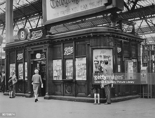 Boots the Chemist which offered photographic developing with a machine dispensing Ilford films next to another for platform tickets