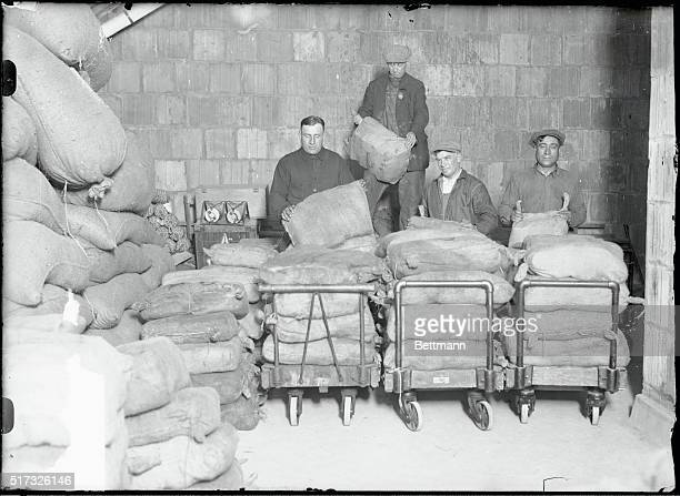 Booze. 2,064 bottles of booze seized by coast guardsmen. New York. The burlap bags containing 2,064 bottles of booze seized by Coast Guardsmen aboard...
