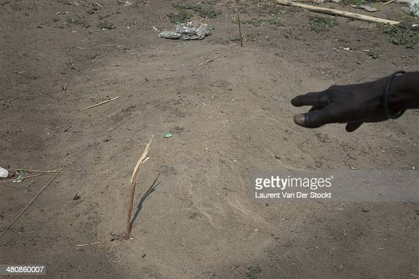 Bor The body of the husband of Mrs Mawan Diing buried hastily in a grave on the side of their house in the district of Marol Photograph Laurent Van...