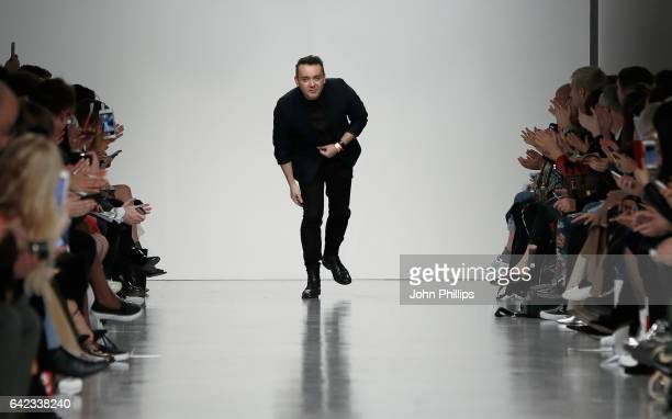 Bora Aksu walks the runway at his show during the London Fashion Week February 2017 collections on February 17, 2017 in London, England.