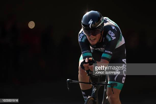 Bora Hansgrohe's Austrian cyclist Lukas Postlberger rides in Malaga during the first stage of the 73rd edition of La Vuelta Tour of Spain cycling...