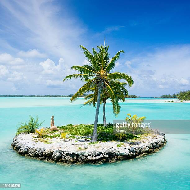 bora-bora island airport lagoon islet tiki statue - small stock pictures, royalty-free photos & images