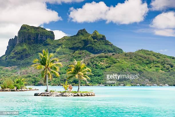 bora-bora island airport lagoon tiki statue islet - tahiti stock pictures, royalty-free photos & images