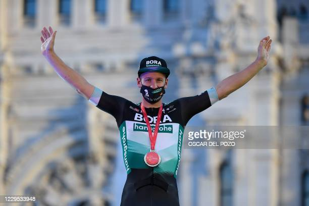 Bora-Hansgrohe's German rider Pascal Ackermann celebrates on the podium after winning the 18th and final stage of the 2020 La Vuelta cycling tour of...
