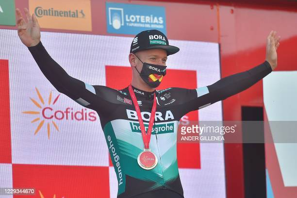 Bora-Hansgrohe's German rider Pascal Ackermann poses on the podium after winning the 9th stage of the 2020 La Vuelta cycling tour of Spain, a...