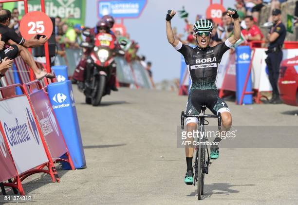 BoraHansgrohe's Polish cyclist Rafal Majka celebrates while crossing the finish line of the 14th stage of the 72nd edition of 'La Vuelta' Tour of...