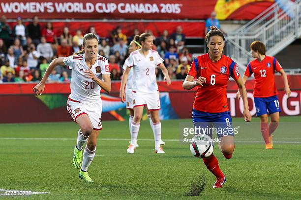 Boram Hwang of Korea Republic chases after the ball against Irene Paredes of Spain during the FIFA Women's World Cup Canada 2015 Group E match...