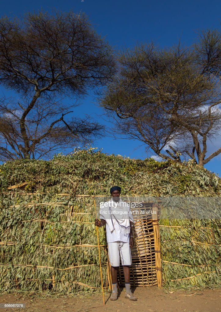 Borana man standing in front of a hut during the Gada system    News