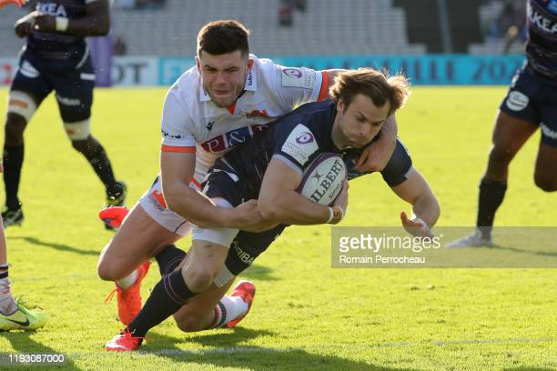 Bordeaux Begles' half back Yann Lesgourgues scores a try during the European Rugby Challenge Cup Round 5 match between Bordeaux Begles and Edinburgh...