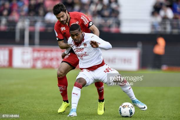 Bordeaux' Brazilian forward Malcom vies with Dijon's French defender Quentin Bernard during the French L1 football match between Dijon and Bordeaux...