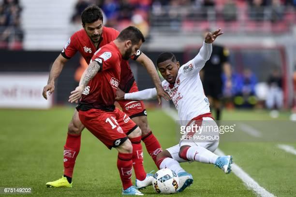 Bordeaux' Brazilian forward Malcom vies with Dijon's French defender Quentin Bernard and Dijon's French midfielder Frederic Sammaritano during the...