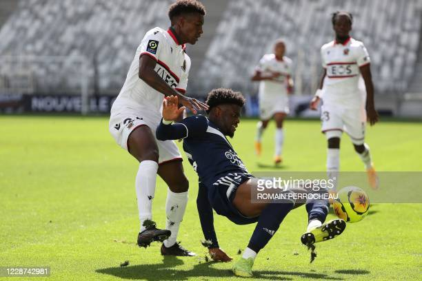 Bordeaux' English forward Josh Maja Battle vie with Nice's Swiss defender Jordan Lotomba during the French L1 football match between Bordeaux and...