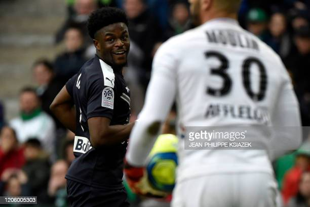Bordeaux' English forward Josh Maja celebrates after scoring a goal during the French L1 football match between SaintEtienne and Bordeaux at the...