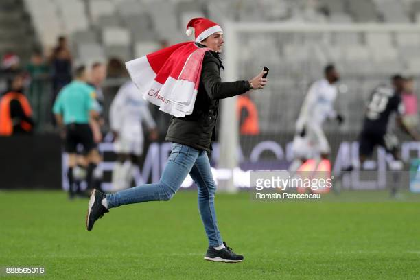 Bordeaux' fans enter into the pitch during the Ligue 1 match between FC Girondins de Bordeaux and Strasbourg at Stade Matmut Atlantique on December 8...