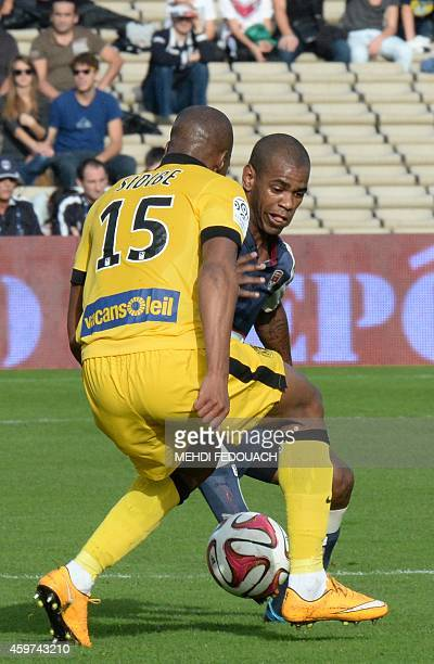Bordeaux' Filho Ferreira vies with Lille's Djibril Sidibe during the French L1 football match Girondins de Bordeaux vs LOSC Lille on November 30 2014...