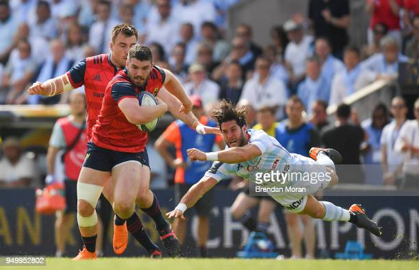 Bordeaux France 22 April 2018 Sam Arnold of Munster is tackled by Maxime Machenaud of Racing 92 during the European Rugby Champions Cup semifinal...