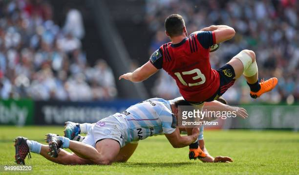 Bordeaux France 22 April 2018 Sam Arnold of Munster is tackled by Camille Chat and Henry Chavancy of Racing 92 during the European Rugby Champions...