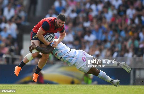 Bordeaux France 22 April 2018 Sam Arnold of Munster is tackled by Virimi Vakatawa of Racing 92 during the European Rugby Champions Cup semifinal...