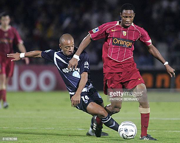 Bordeaux' midfielder Julien Faubert is challenged by RC Lens' midfielder Olivier Thomert during their French L1 football match 30 October 2004 at...