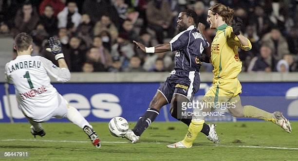 Bordeaux's French forward JeanClaude Darcheville shoots the ball in front of Nantes's Argentinean defender Mauro Cetto and French goalkeeper Mickael...