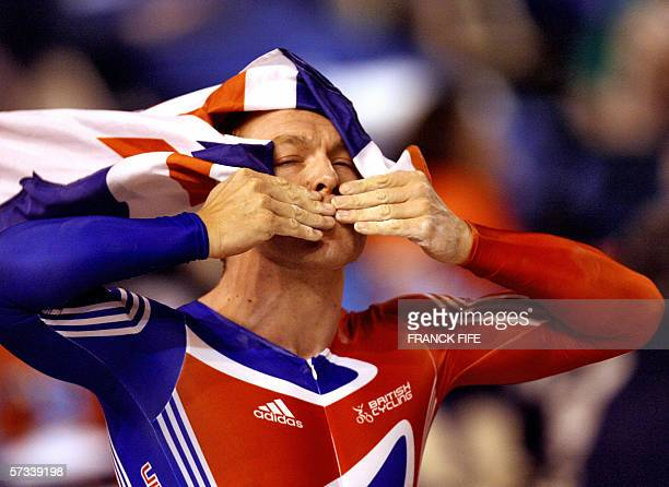 Great Britain's Chris Hoy celebrates after winning the men's 1 km Time Trial final during the UCI Track Cycling World Championships in Bordeaux, 14...