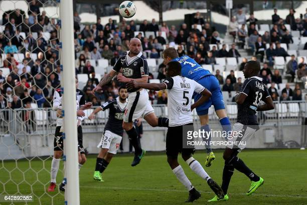 Bordeaux' French defender Nicolas Pallois scores a goal during the French L1 football match between Bordeaux and Guingamp on February 19 2017 at the...