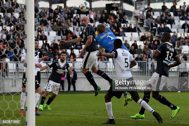 Bordeaux' French defender Nicolas Pallois scores a header during the French L1 football match Bordeaux vs Guingamp on February 19 2017 at the Matmut...
