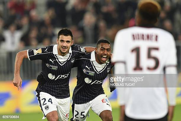 Bordeaux' French forward Gaetan Laborde celebrates with teammate Bordeaux' Brazilian forward Malcom after scoring a goal during the French League Cup...