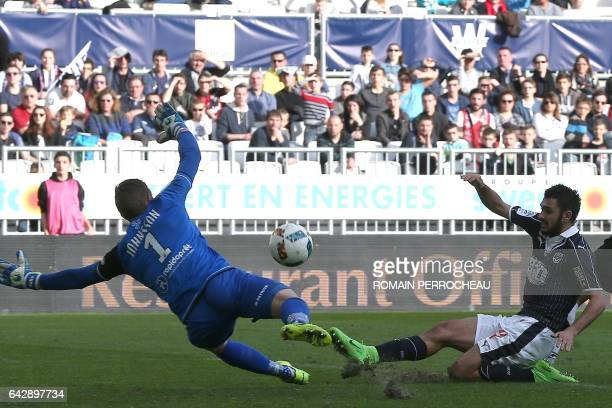 Bordeaux' French forward Gaetan Laborde scores a goal during the French L1 football match between Bordeaux and Guingamp on February 19 2017 at the...