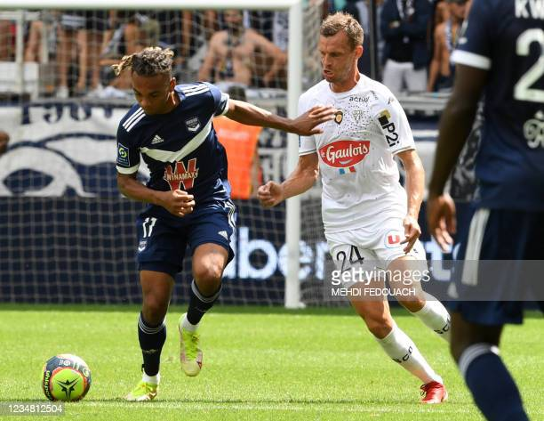 Bordeaux' French forward Mara Sekou challenges Angers' French defender Thomas Romain during the French L1 football match between FC Girondins de...