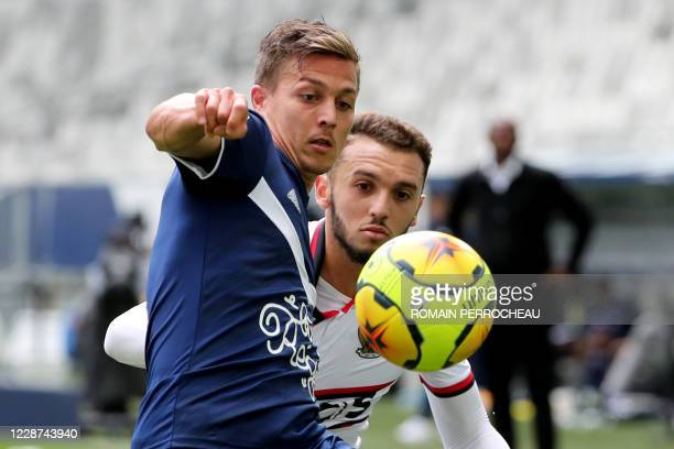 Bordeaux' French forward Nicolas De Preville and Nice's Algerian forward Amine Gouiri vie during the French L1 football match between Bordeaux and...
