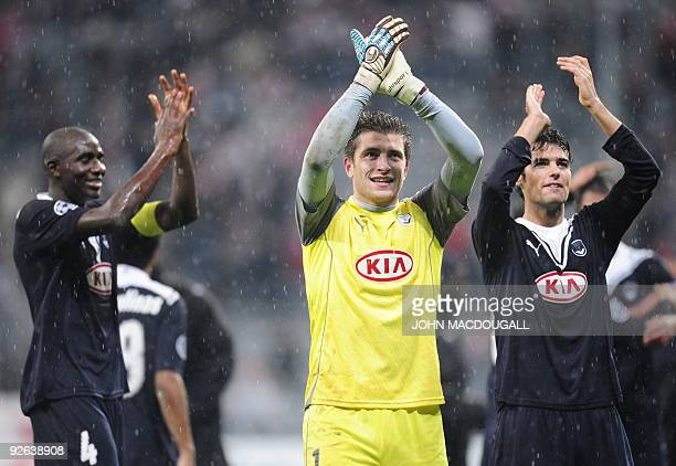 Bordeaux' French midfielder Alou Diarra, Bordeaux' French goalkeeper Cedric Carrasso and French midfielder Yoann Gourcuff celebrate with supporters...