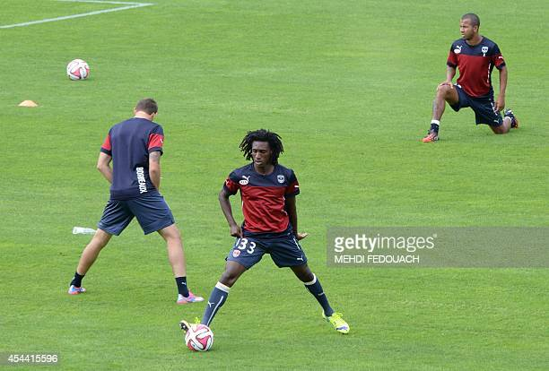 Bordeaux' French midfielder Sessi d'Almeida and teammates warm up prior to the French L1 footbal match Bordeaux vs Bastia on August 31 2014 at the...
