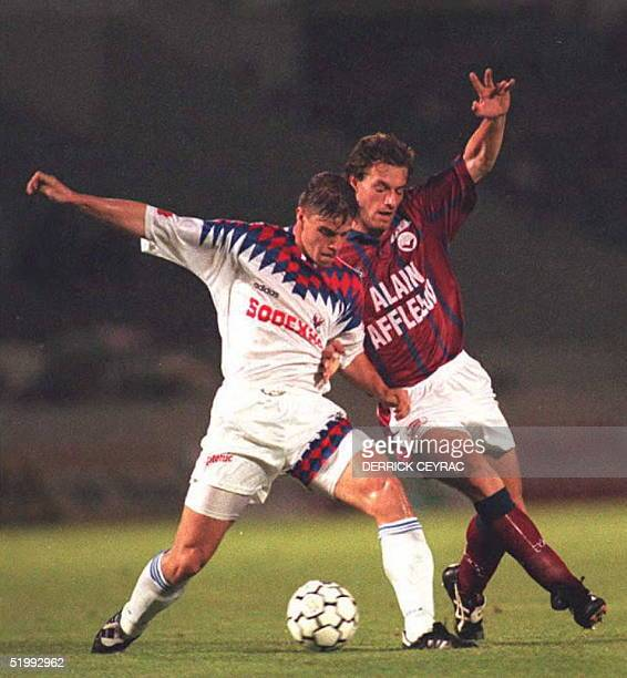 Bordeaux ' Jean-Luc Dogon battles for the control of the ball with Lyon 's Marcelo of Brazil as part of France 's First Division soccer championships...