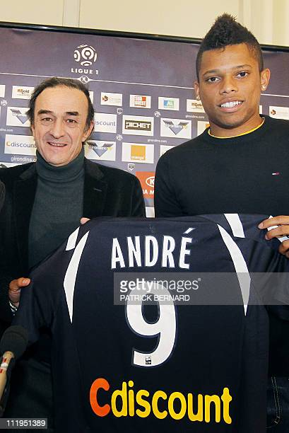 Bordeaux L1 football club's newly recruited Brazilian Andre Felipe Ribeiro de Souza aka Andre poses with his shirt near the club's president...