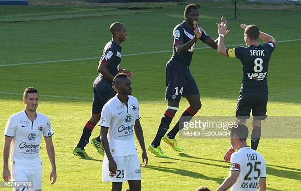 Bordeaux' Malian forward Cheick Diabate celebrates scoring a penalty during the French L1 footbal match between Bordeaux and Caen at the ChabanDelmas...