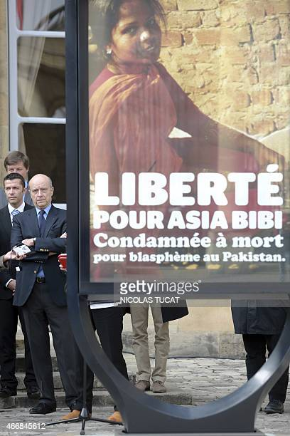 Bordeaux Mayor Alain Juppe attends on March 19, 2015 the unveiling of a poster in the courtyard of the City Hall in the southwestern French city in...