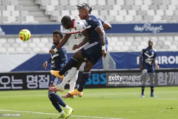 Bordeaux' Nigerian forward Samuel Kalu, Nice's French defender Hassane Kamara and Bordeaux' English forward Josh Maja Battle vie during the French L1...