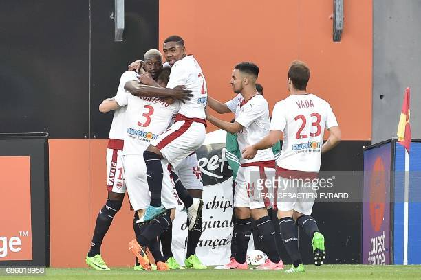 Bordeaux 's French midfielder Younousse Sankhare celebrates with his teammates after scoring a goal during the French L1 football match between...